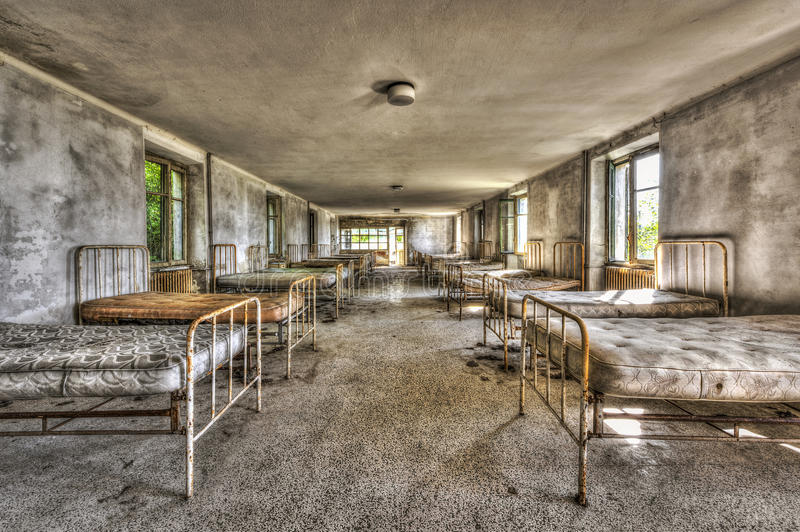 Dilapidated dormitory in an abandoned children hospital royalty free stock photos