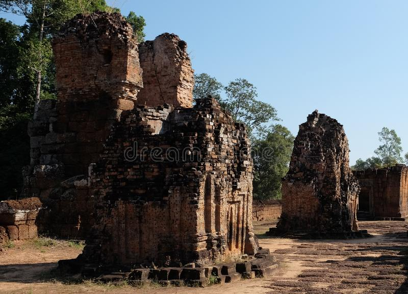 Dilapidated Khmer baray. Medieval brick buildings. Architectural monument.  royalty free stock image