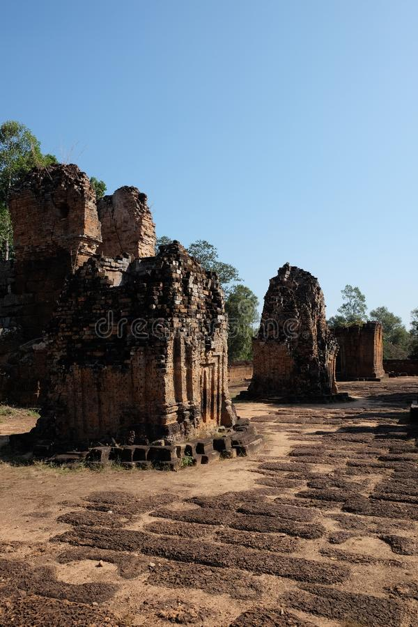 Dilapidated Khmer baray. Medieval brick buildings. Architectural monument.  stock photos