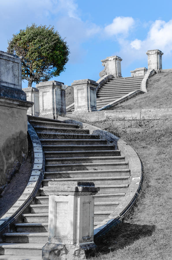 Dilapidated old stone staircase leading into the sky... royalty free stock photo