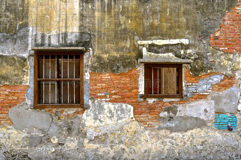 Dilapidated Brick Wall With Plaster And Window Stock Photo