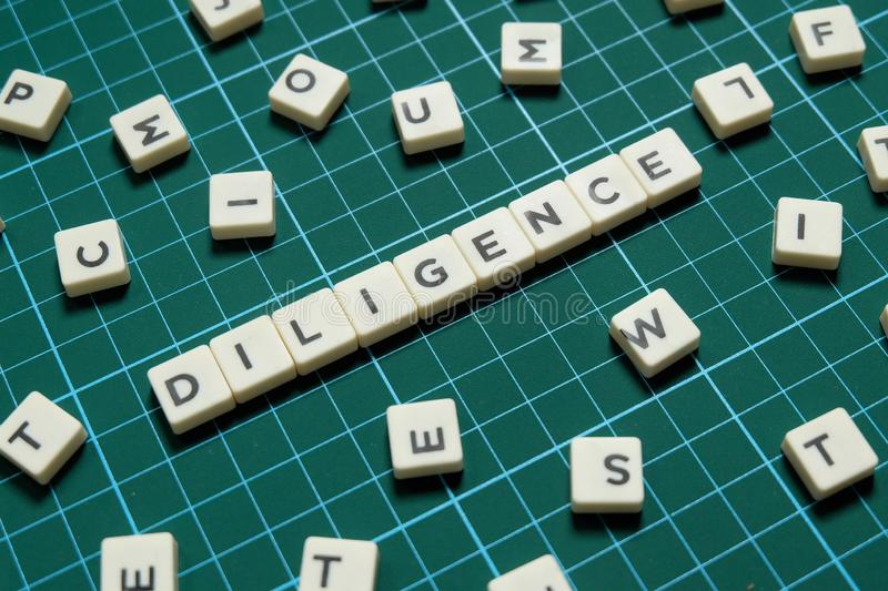 Diligence word made of square letter word on green square mat background. Diligence word made of square letter word on green square mat background stock photography