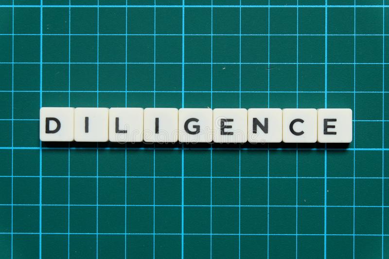 Diligence word made of square letter word on green square mat background. Diligence word made of square letter word on green square mat background royalty free stock photography
