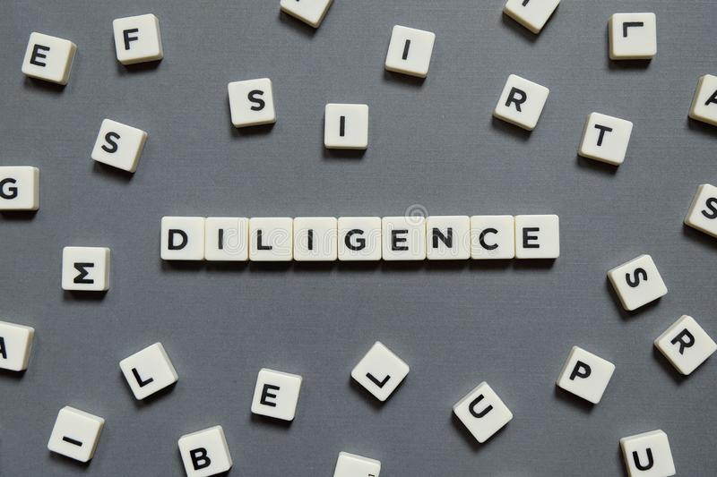 Diligence word made of square letter word on grey background. Diligence word made of square letter word on grey background stock images