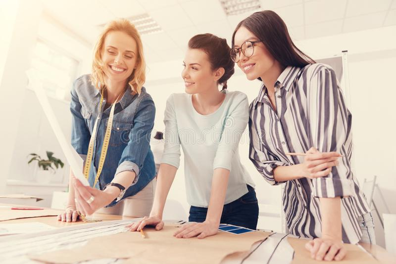 Diligent team of designers working in the studio royalty free stock images