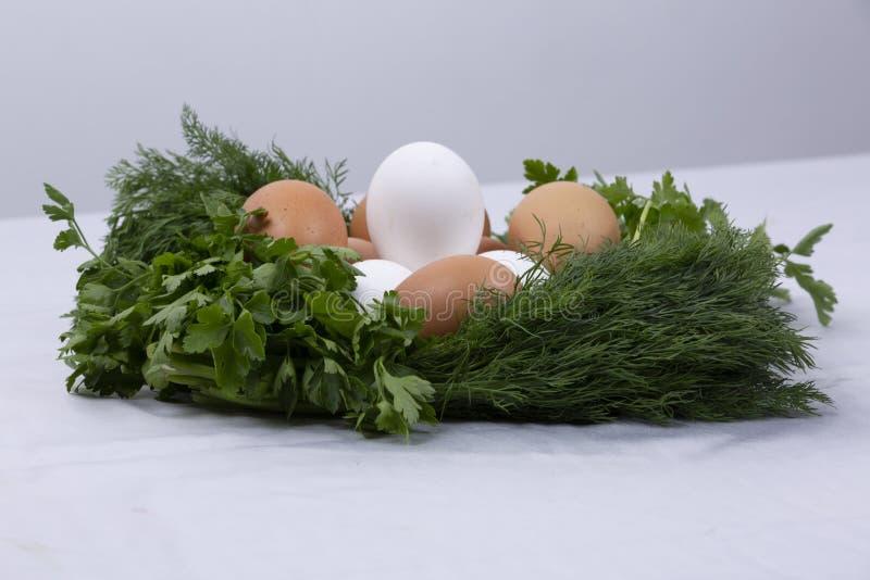 Dill parsley wreath with eggs stock photos