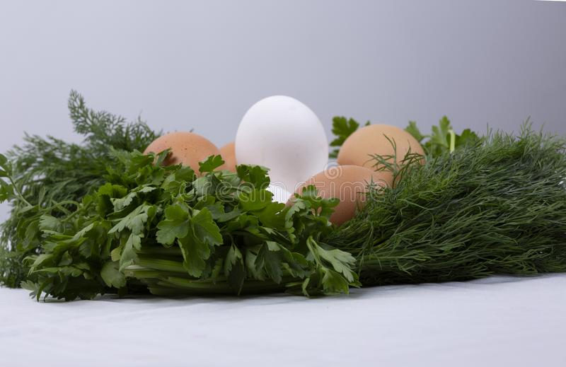 Dill parsley wreath with eggs royalty free stock images