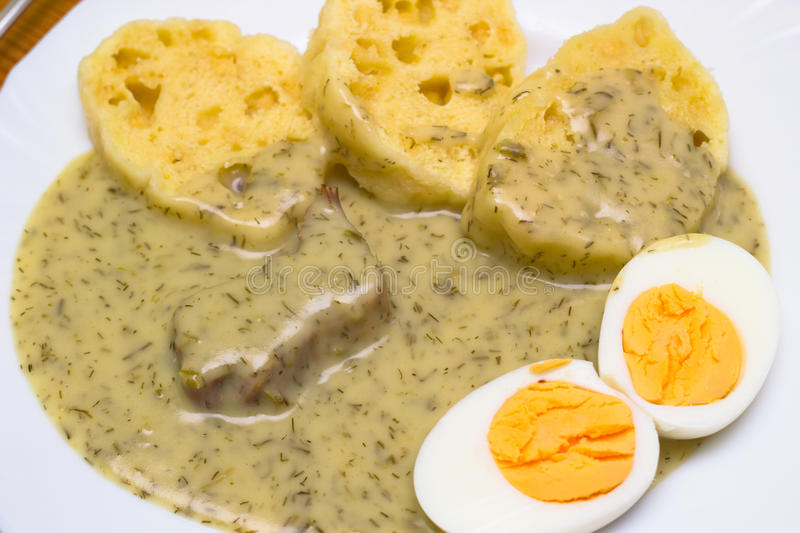 Dill sauce. Boiled beef with dill sauce, bread dumplings and cooked hard-boiled eggs stock image