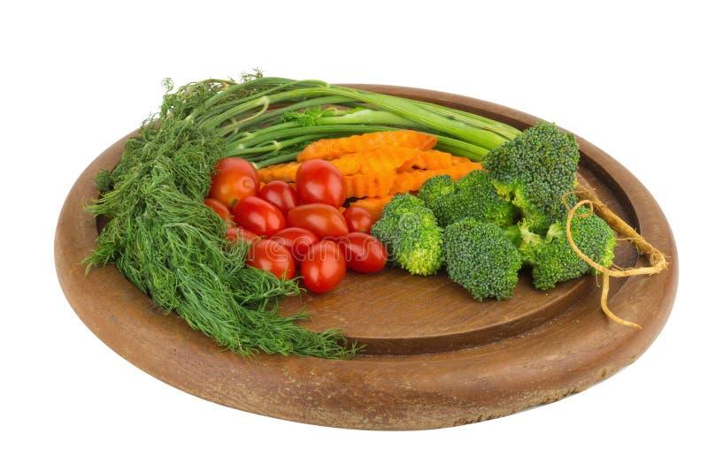 dilled Dziecko pomidory marchew brokuły na starym ciapania borad zaleca się zdjęcie stock