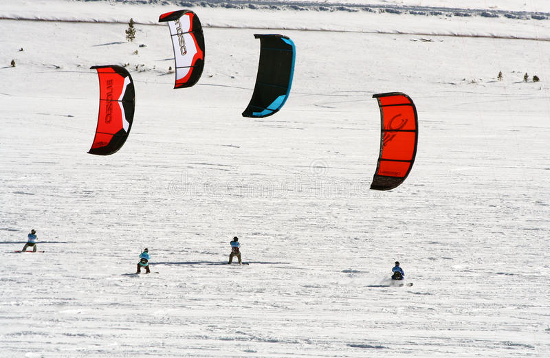 Dillon Snowkite Open. Ski kiting on a frozen lake during the Dillon Snowkite Open in Dillon, Colorado. This event consists of four days of competition and royalty free stock photography