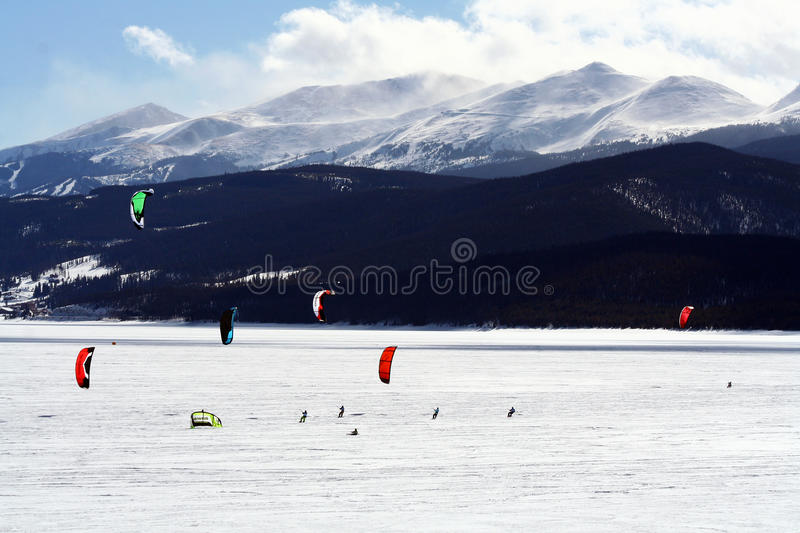 Dillon Snowkite Open. Ski kiting on a frozen lake during the Dillon Snowkite Open in Dillon, Colorado. This event consists of four days of competition and stock images