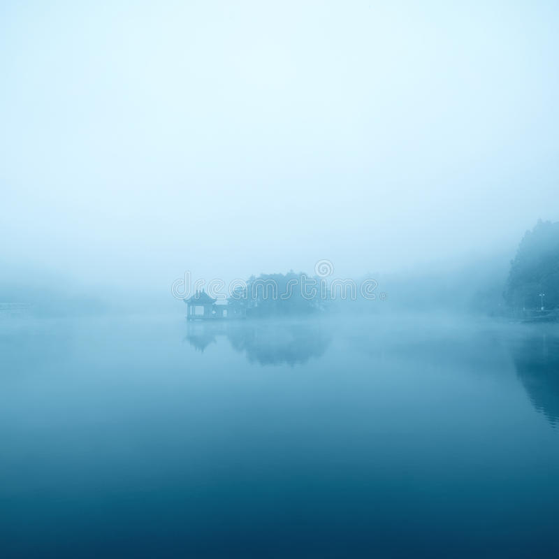 Dim lake. In the fog royalty free stock photo