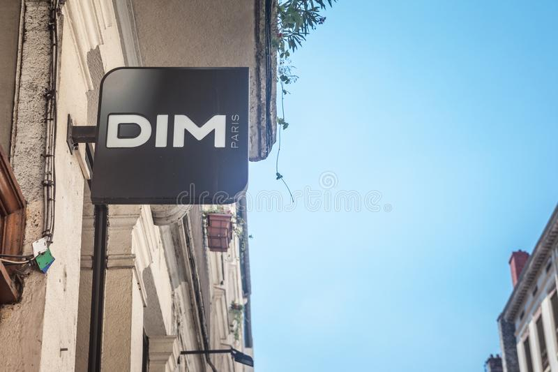 Dim logo on their main store in Lyon. Dim lingerieis an French fashion clothing retail brand  specialized in underwear stock photography
