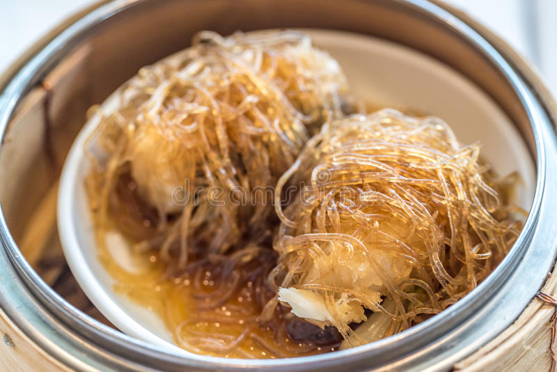 Dim sum Sea Bass with vermicelli. Chinese dim sum Sea Bass with vermicelli - Steamed Chinese groumet cuisine royalty free stock photos