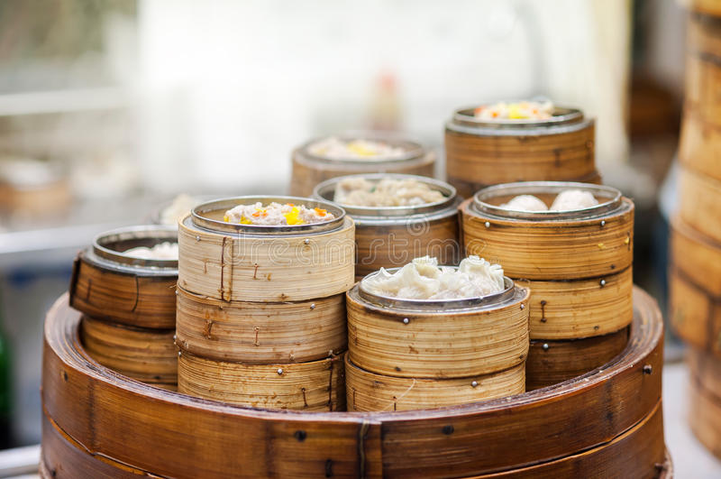 Dim sum steamers at a Chinese restaurant, Hong Kong. Dim sum is popular throughout Hong Kong and Cantonese-speaking communities. The food is usually steamed and royalty free stock images
