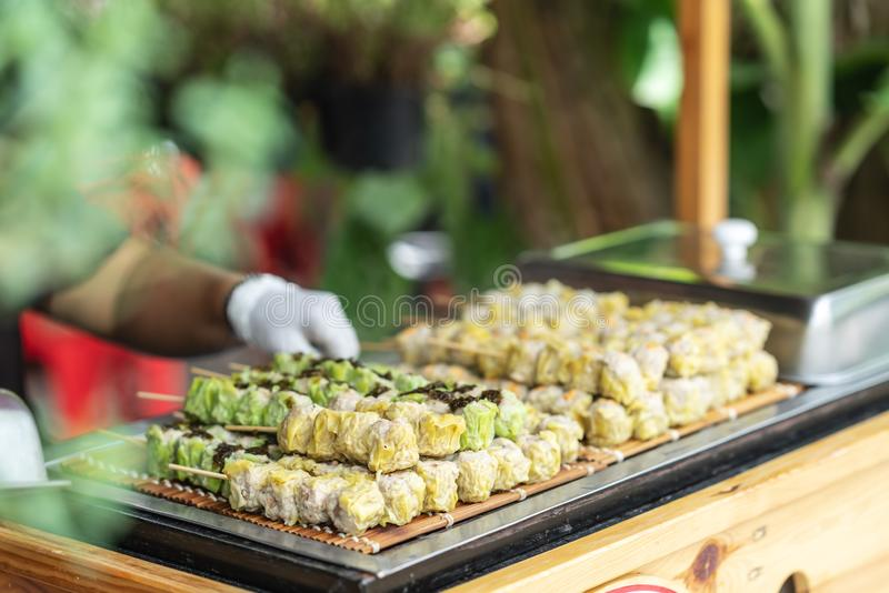 Dim sum on stick ready to eat in street food market. In bangkok thailand. Tasty but dirty dumpling royalty free stock image