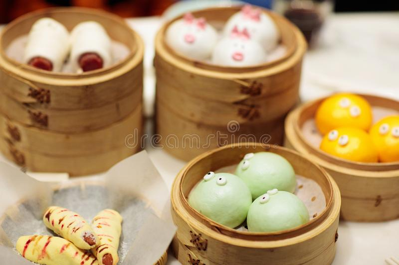 Dim sum, traditional Chinese dumpling in bamboo steamer, pig and animal theme for kids. Street food for children in China, Hong stock image