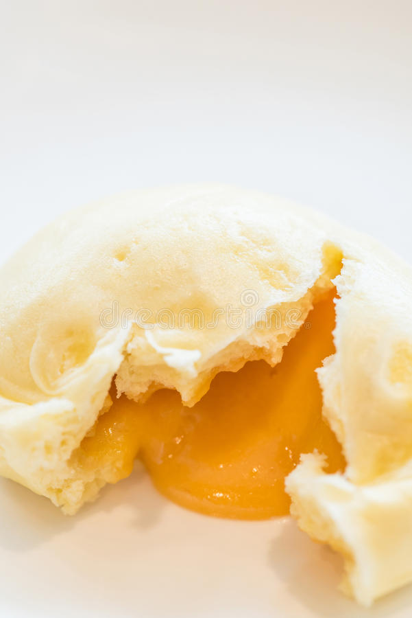 Dim sum yolk lava Bun. Chinese dim sum yolk lava Bun - Steamed Chinese groumet cuisine stock image