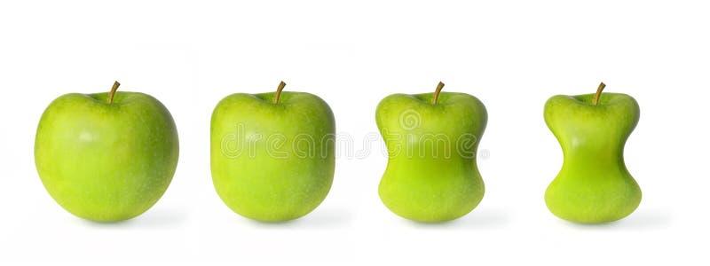 Dimagramento verde delle mele isolato su fondo bianco immagine stock