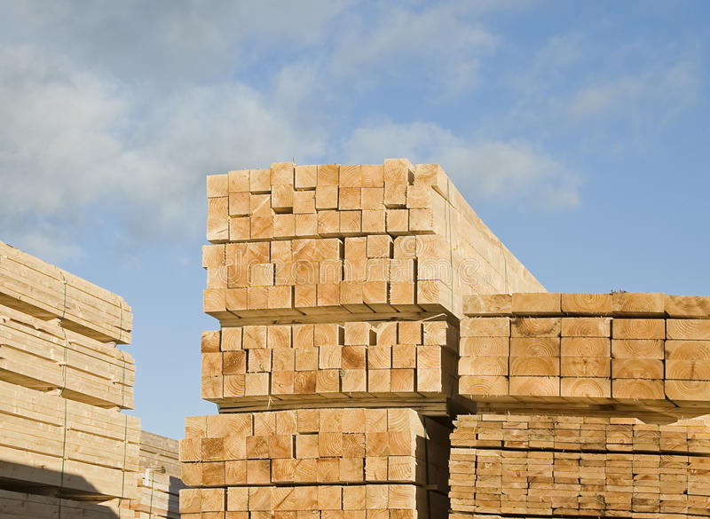 Dimensional timber. Stacks of timber of different sizes: two by two, two by four, and one by four sizes royalty free stock photo