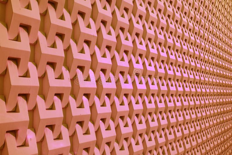 Diminishing Perspective of a Building Decorative Facade in Pink Color royalty free stock images