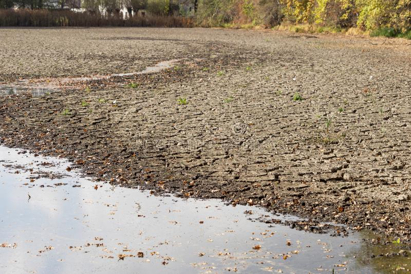 Diminishing water and drought in the pond stock image