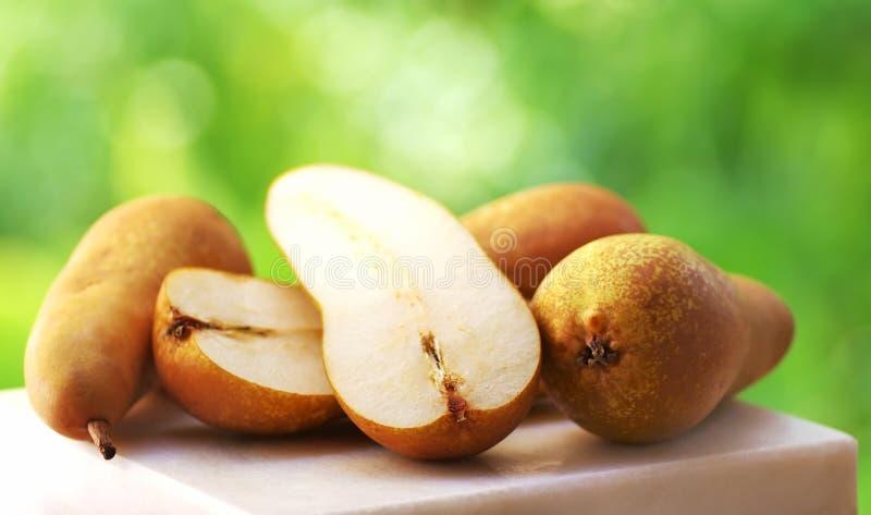 Diminua peras de Fetel na tabela foto de stock royalty free