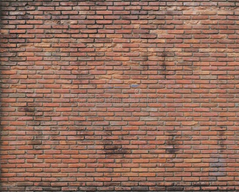 Dimly lit old brick wall stock photos