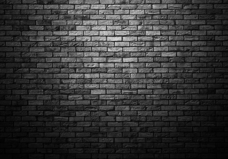 Dimly lit old brick wall. Dimly lit old brick gray wall with ligth vignette