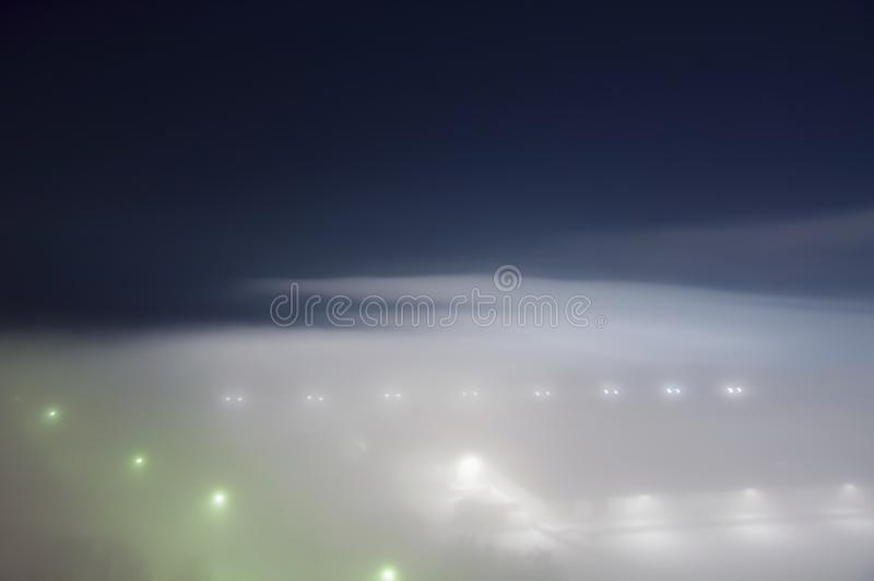 Dimma i stadsdalen arkivbild