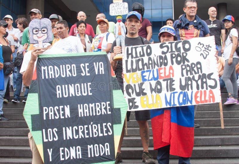 Dimostranti a Caracas contro i goverments venezuelani fotografie stock