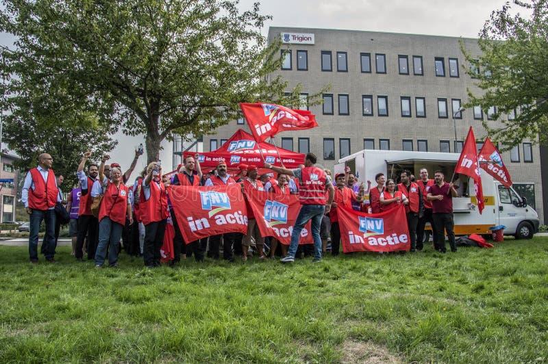 Dimostrazione degli impiegati di Trigion per un migliore accordo di occupazione collettivo alle sedi di Trigion Amsterdam il Neth fotografie stock