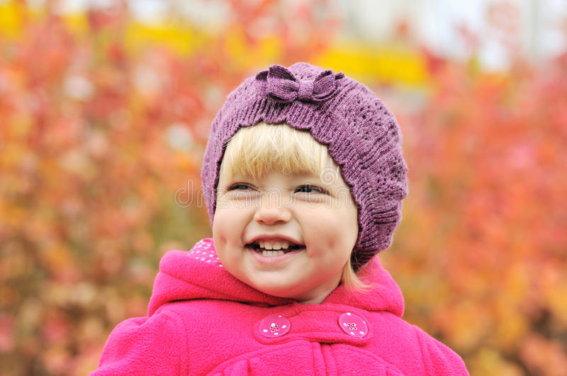 Dimple cheeks. Baby girl smiling with dimple cheeks royalty free stock photos