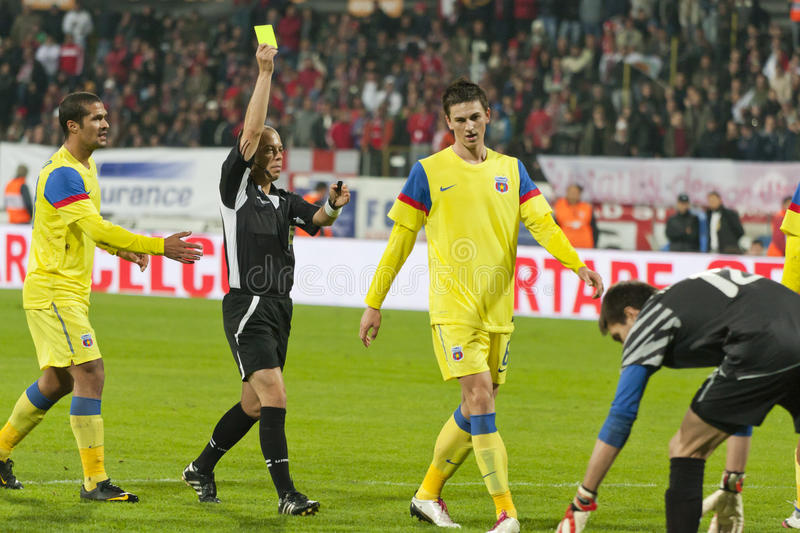 Dinamo Bucharest - Steaua Bucharest. Central referee showing the yellow card to Mihai radut in the match against Steaua Bucharest on Stefan cel Mare Arena. The royalty free stock images