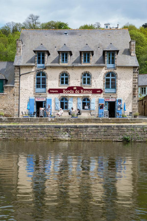 Dinan, Brittany May 7th 2013 : Creperie restaurant in Dinan reflected in the Rance river stock images