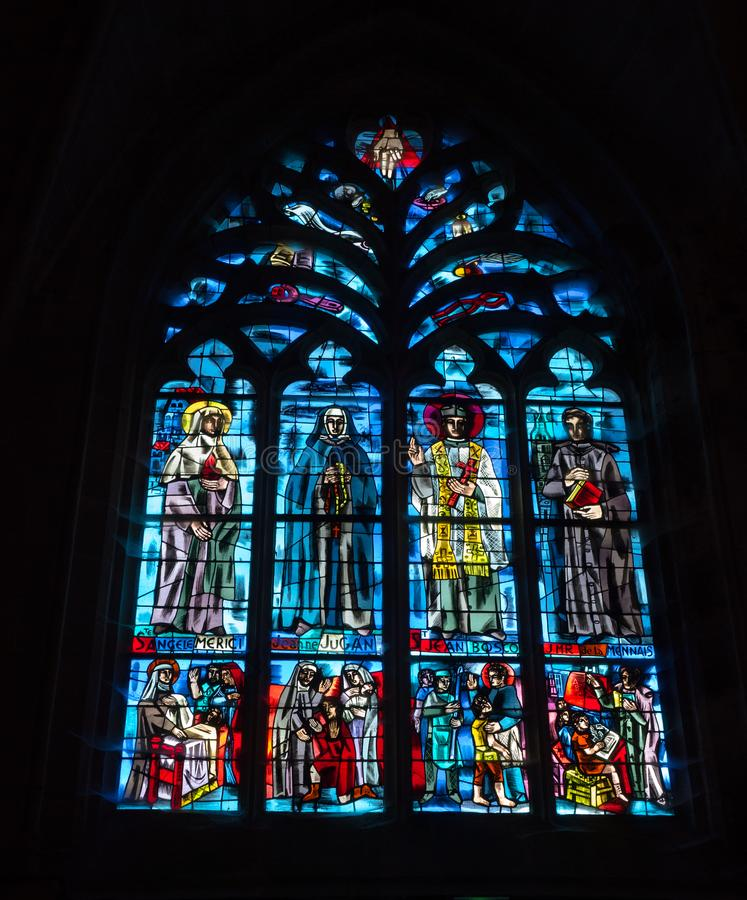 A detailed view of a stained glass window in the Basilica de Saint-Sauveur in Dinan in Brittany royalty free stock photos