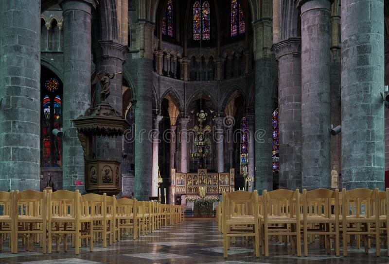 Dinant/Belgium - October 10 2019:  Rear or back view of empty church, selective focus to seats royalty free stock photo