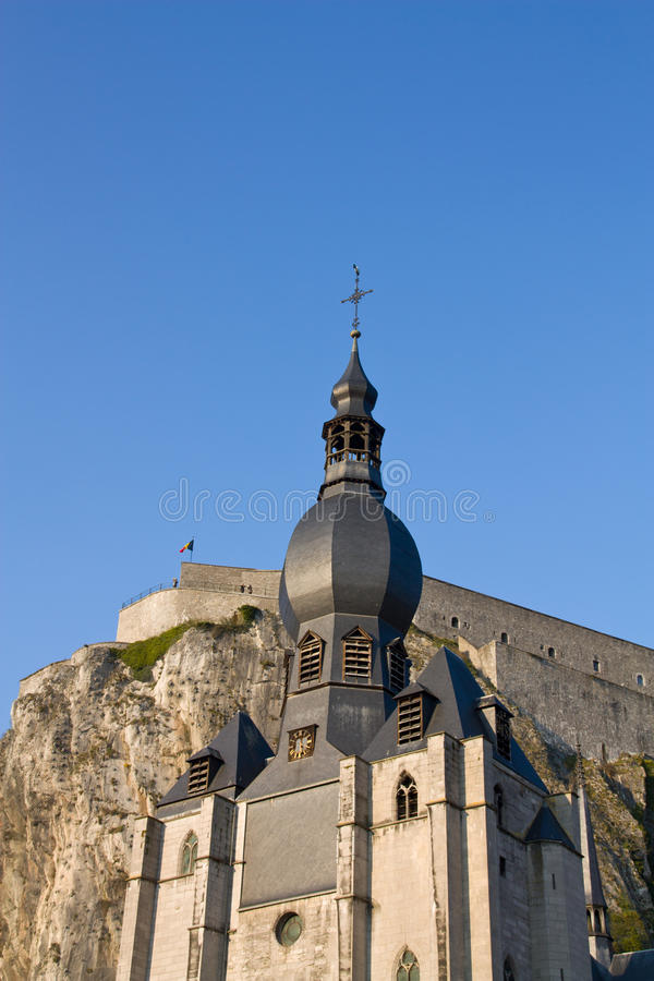 Dinant church and citadel. Dinant it is an splendid little town in Belgium, Europe. Perched high above the Meuse Valley, the citadel takes you back into the stock photography