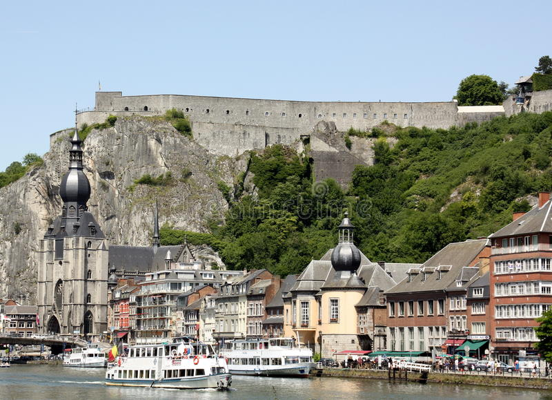 Dinant. June-06-2014. Citadel on a rock and the Onze-Lievevrouwen-Church in the center of . Belgian Ardennes stock images