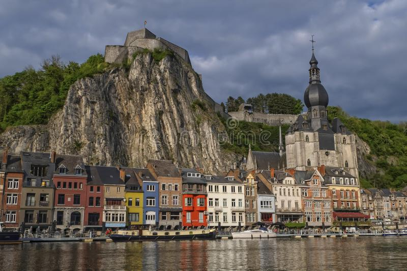 Dinant town view by beautiful sunset, Belgium. Colorful Dinant town view with its citadel and church by sunset, Belgium stock images