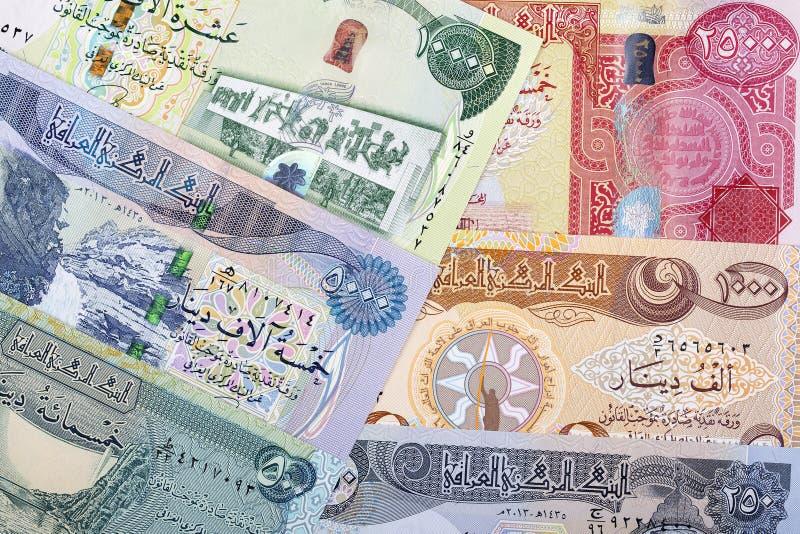 Dinar iraquiano um fundo fotografia de stock