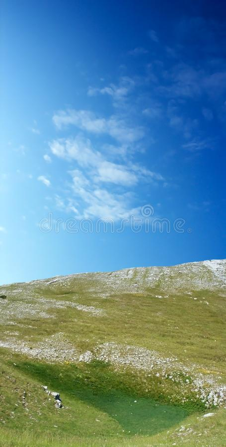 Dinara mountain over blue sky royalty free stock photo