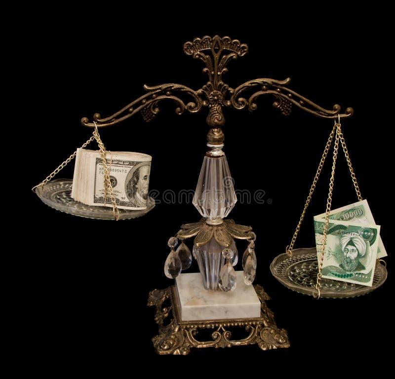 Dinares iraquíes y dólar americano imagen de archivo libre de regalías