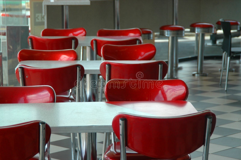 The Diner. Red chairs and stools in an old fashined diner royalty free stock photo
