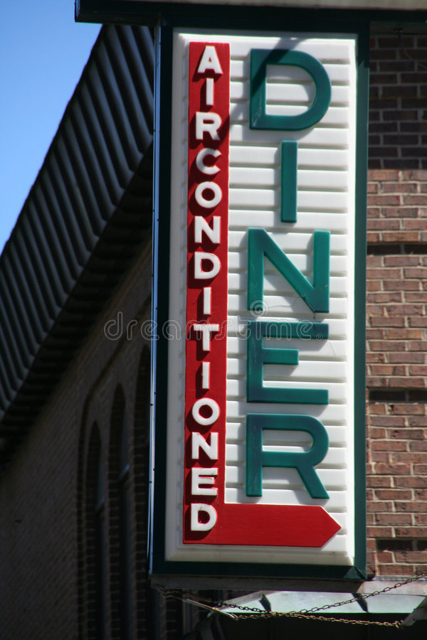Diner sign on brick building, stock photography