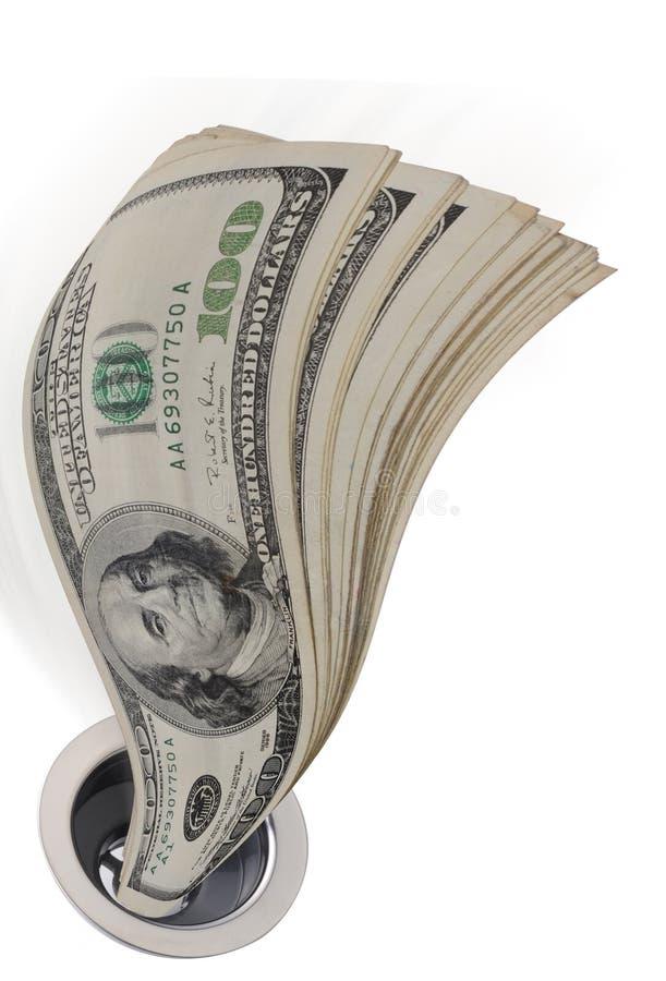Dinero abajo del dren imagen de archivo libre de regalías