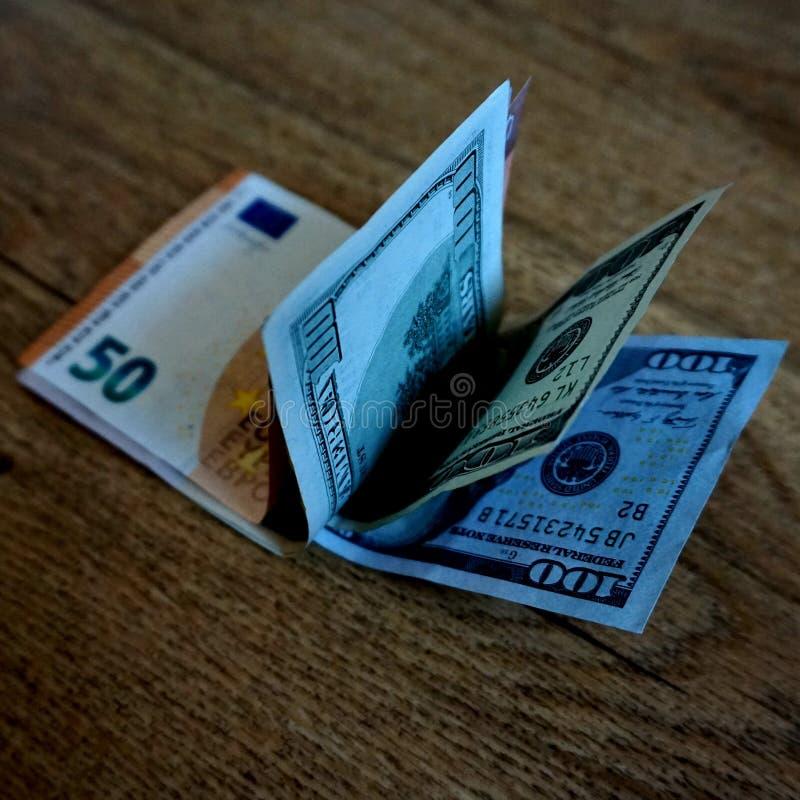 Dinero apilado: dólares y euros fotografía de archivo libre de regalías