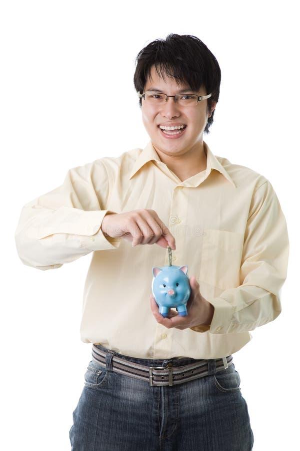 Dinero asiático del ahorro del hombre de negocios foto de archivo