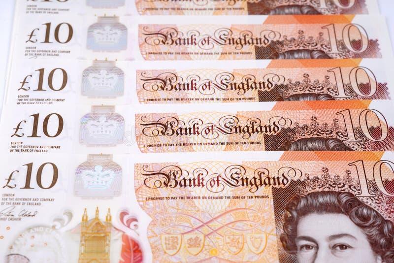Dinero británico diez notas de la libra imagenes de archivo