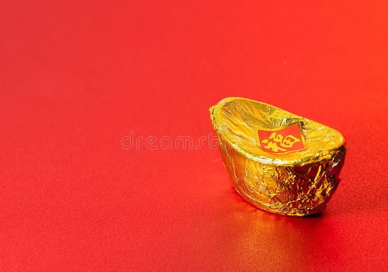 Dinero chino antiguo de los lingotes del papel de aluminio del oro para la tarjeta de felicitación lunar china del Año Nuevo con  imágenes de archivo libres de regalías